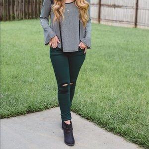 Blue asphalt Dark green distressed jeans.